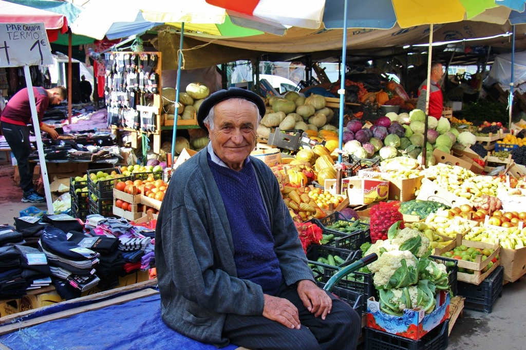 Old Man sits on cart at Green Market in Prishtina, Kosovo
