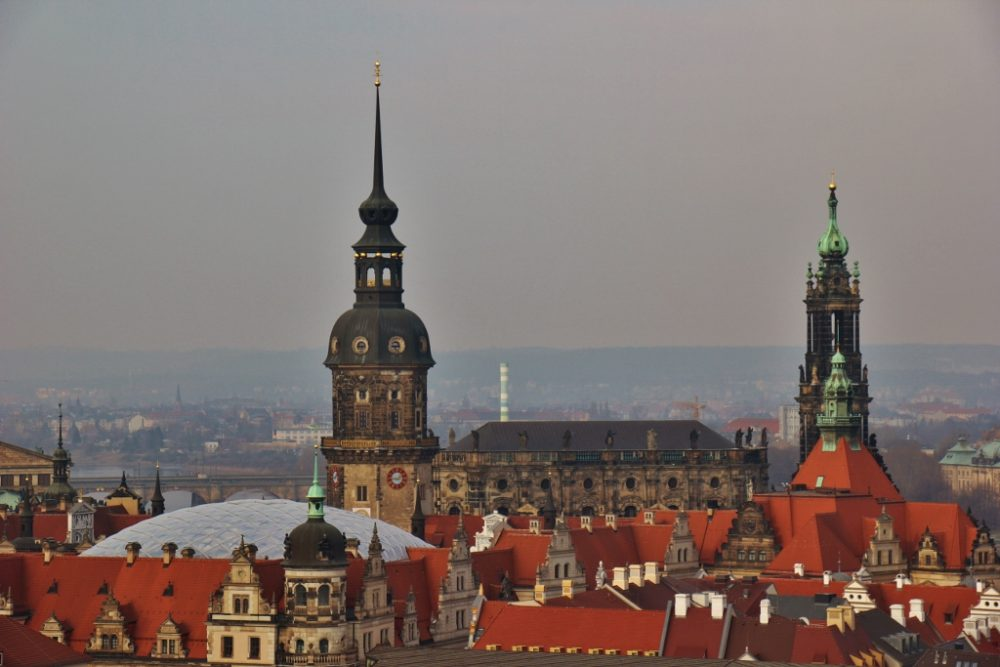 Orange rooftops and Gothic church spires in Dresden, Germany