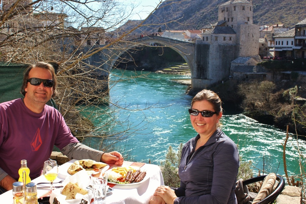 Eating traditional Bosnian fare at riverside restaurant in Mostar, Bosnia-Herzegovina