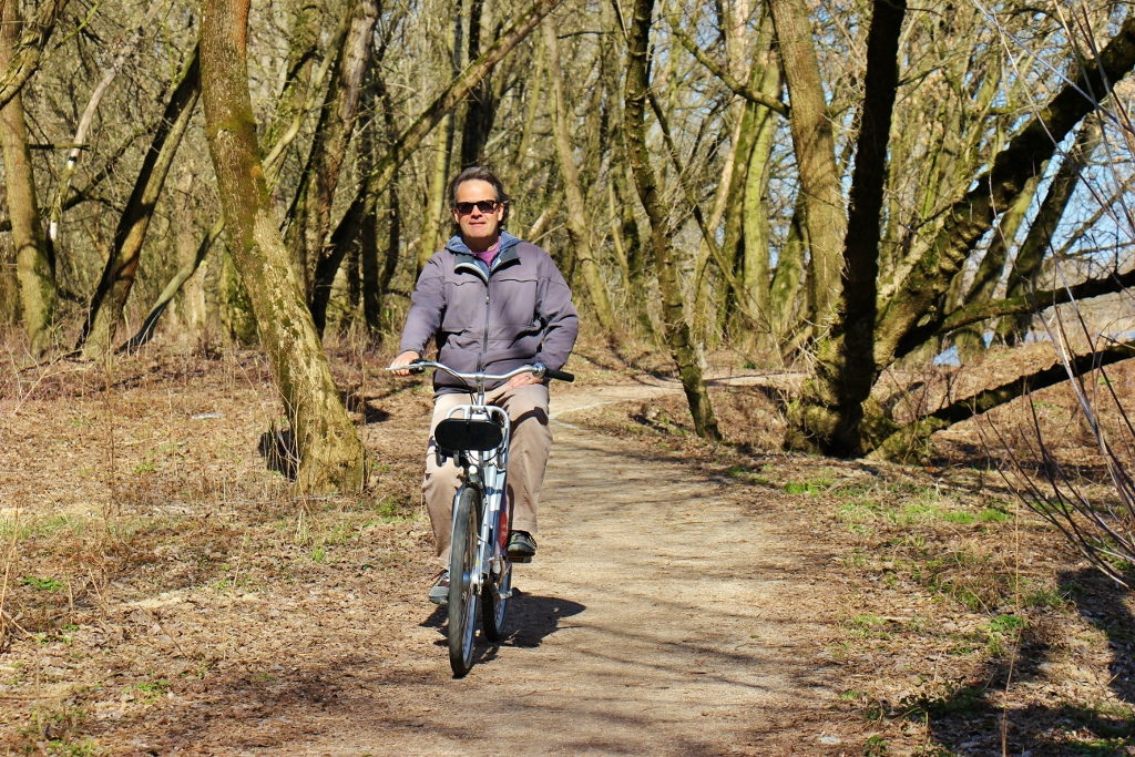 Riding Veturilo bikes through riverside park in Warsaw, Poland