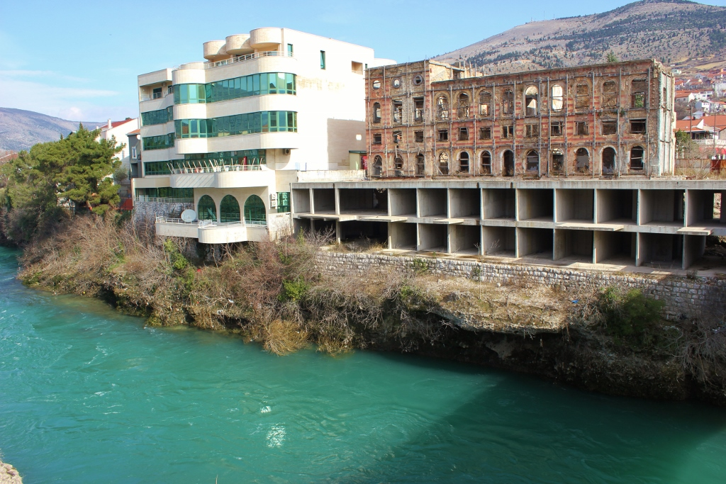 Contrasting architecture of new and war-torn in Mostar, Bosnia-Herzegovina