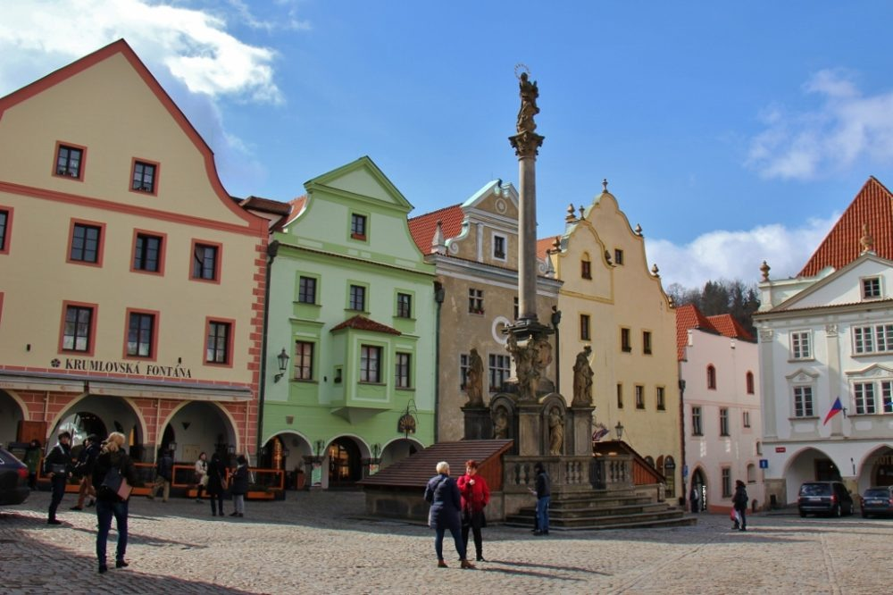 Plague Column and colorful buildings on Town Square, Cesky Krumlov, Czech Republic