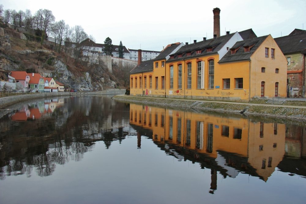 Building reflections on the Vltava River, Old Town, Cesky Krumlov, Czech Republic