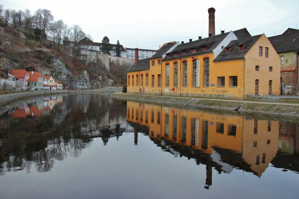 Building reflections on the Vltava River, Old Town, Cesky Krumlov, Czech Republic