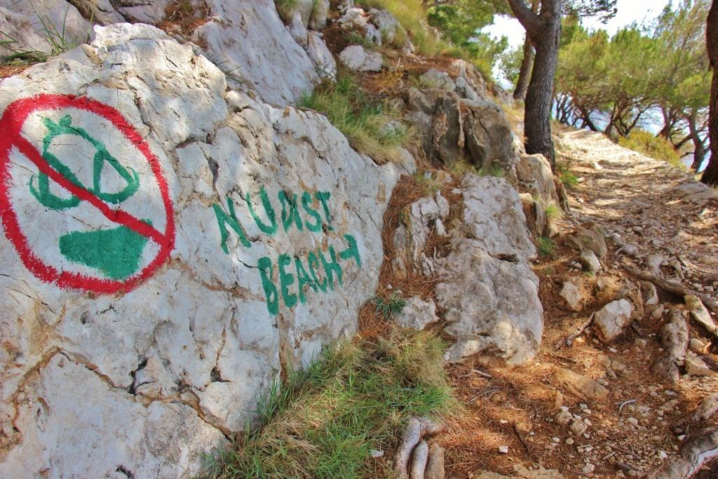 Nudist Beach sign, Makarska, Croatia - Jetsetting Fools