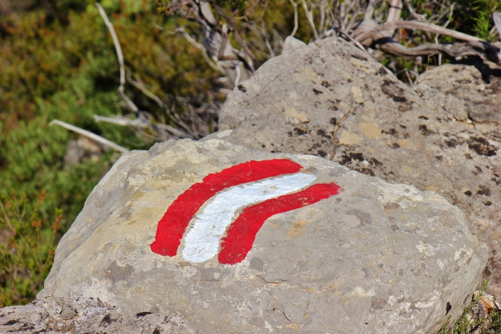 Red and white striped trail marker on Vidova Gora, on Brac, Croatia