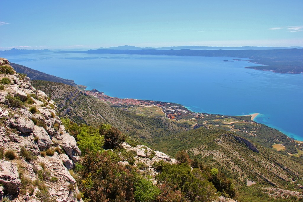View of Bol and Zlatni Rat Beach from Vidova Gora peak on Brac, Croatia
