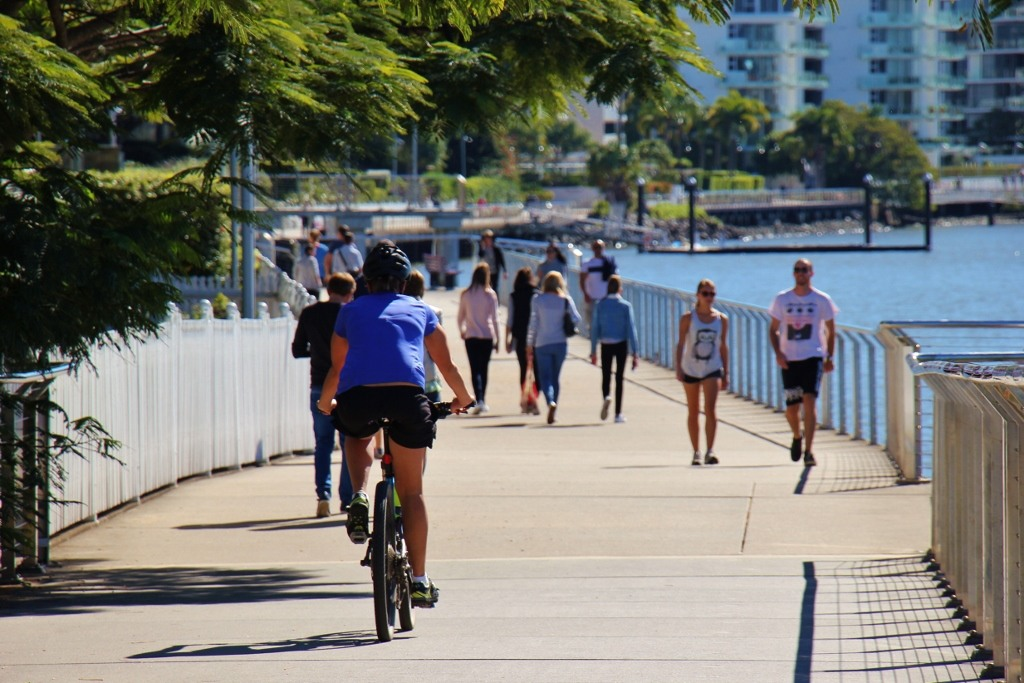 Bikers and walkers on riverside path in Brisbane, Australia