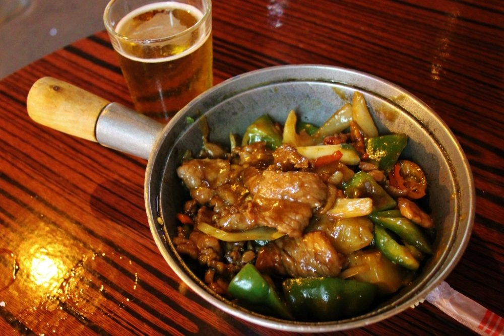 Satay Beef Pot and beer at Tak Kee Seafood Restaurant in Hong Kong