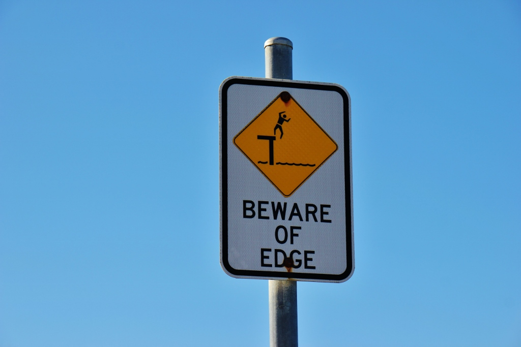 Yellow Beware of Edge sign on Great Ocean Road, Australia, JetSettingFools.com