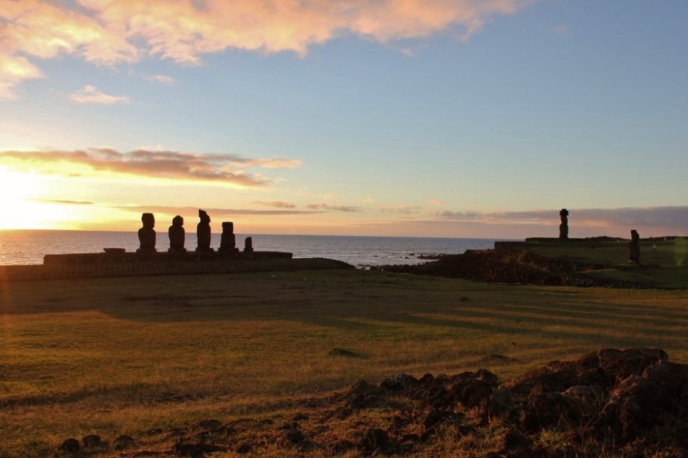Sunsetting on three moai platforms at Tahai on Easter Island JetSettingFools.com