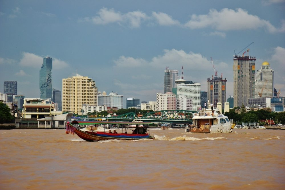 Boats on the busy Chao Phraya River in Bangkok, Thailand