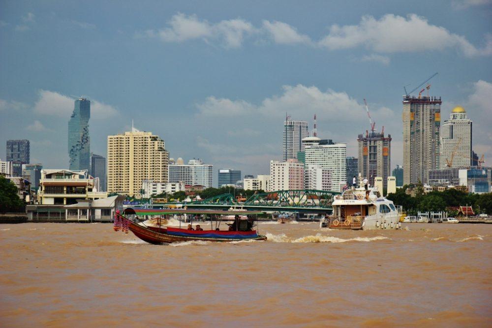 Boats on the busy Chao Phraya River in Bangkok, Thailand