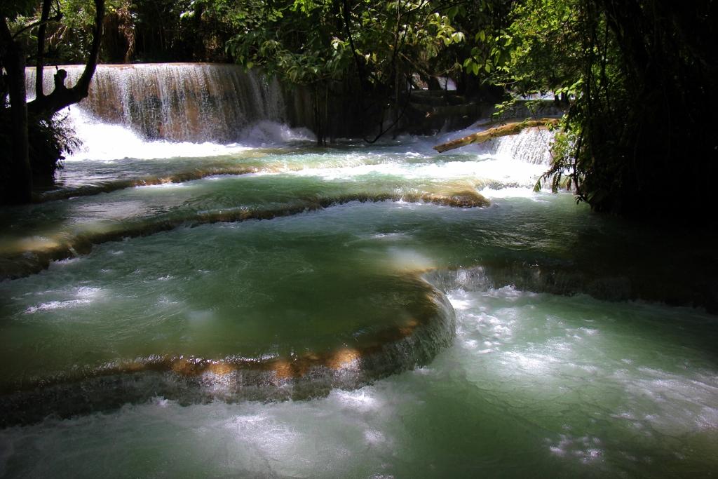 Flowing waterfalls at Kuang Si Waterfalls in Luang Prabang, Laos
