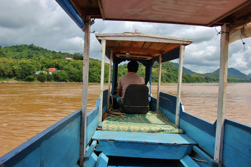 Riding a Mekong River taxi boat in Luang Prabang, Laos