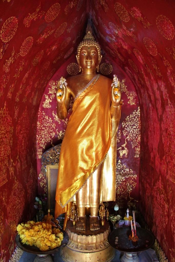 Statue in small temple at Wat Xieng Thong in Luang Prabang, Laos