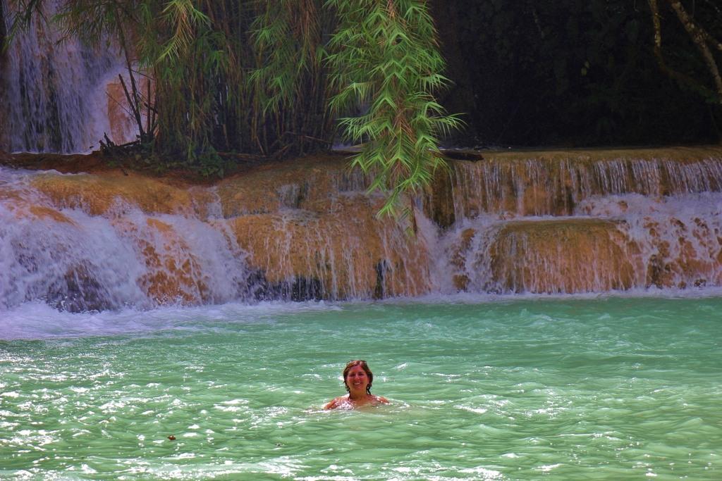 Swimming in clear, blue water at Kuang Si Waterfalls in Luang Prabang, Laos