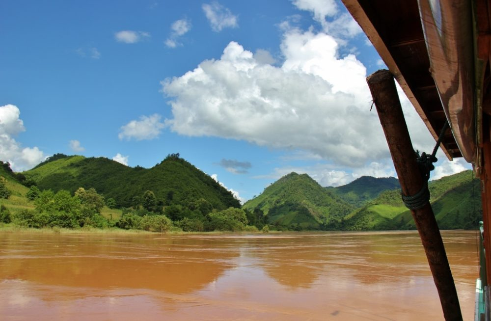 Distant mountains under blue sky on Mekong River, Laos