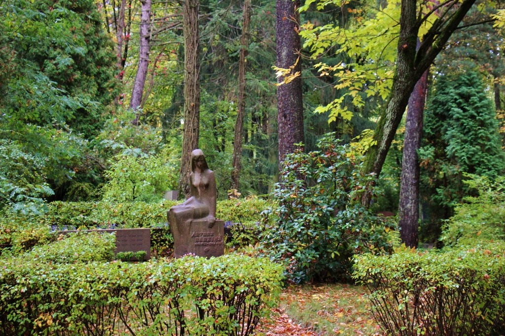 Gravestone among the trees at Forest Cemetery in Riga, Latvia