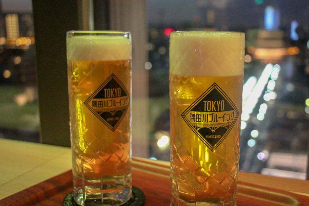 Glasses of beer at Miharashi Cafe at Asakusa Culture Information Center in Tokyo, Japan