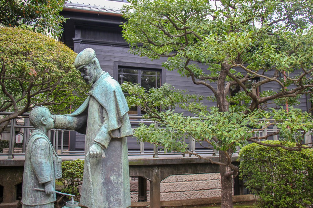 Statue in garden at Nogi Shrine in Tokyo, Japan