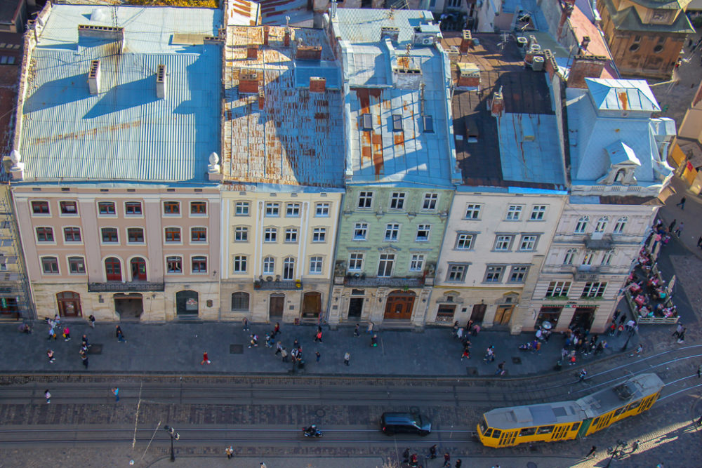 View of a tram rattling through the city from the Town Hall Clock Tower in Lviv, Ukraine