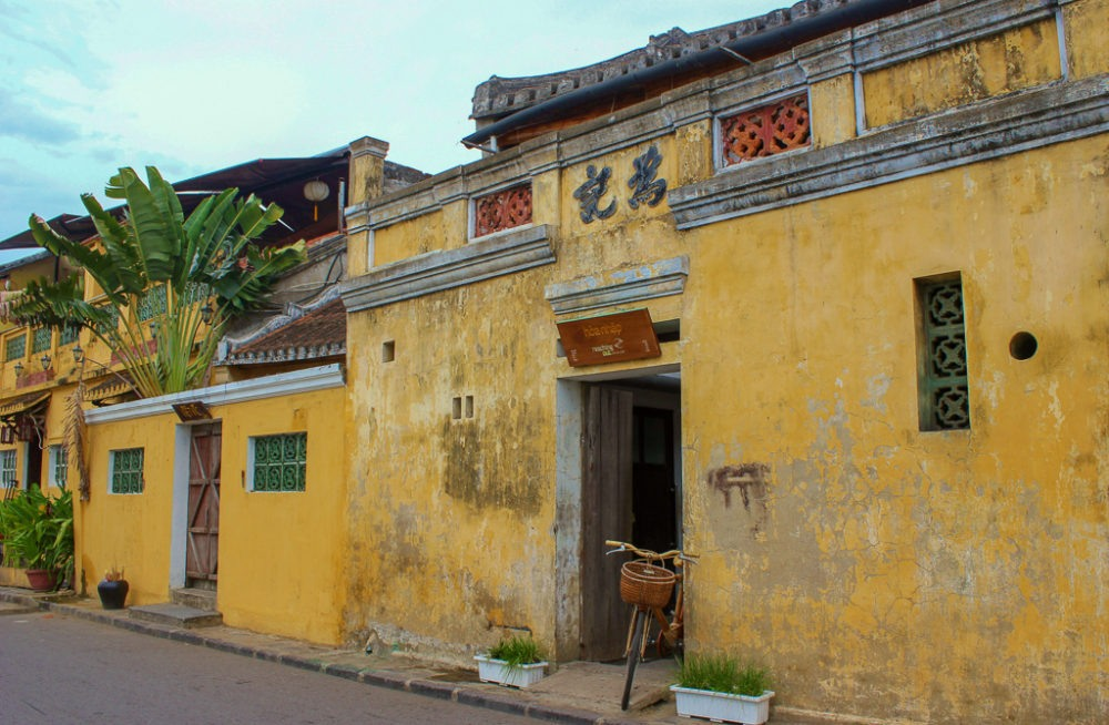 A bicycle outside historic architecture in Hoi An, Vietnam