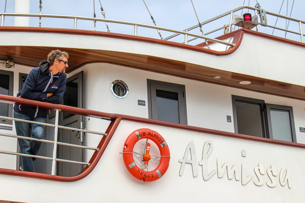 Captain Jure stands aboard the Almissa on Sail Croatia Explorer Cruise