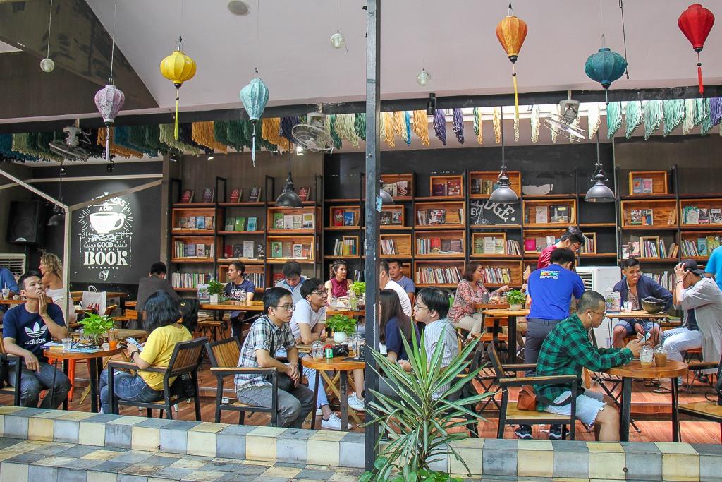 People reading and drinking coffee on Book Street, Saigon, HCMC, Vietnam