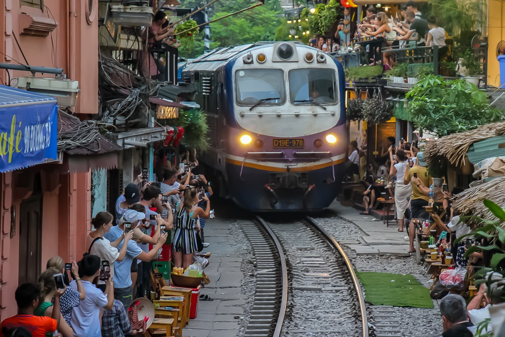 Train on tracks between houses in Hanoi, Vietnam